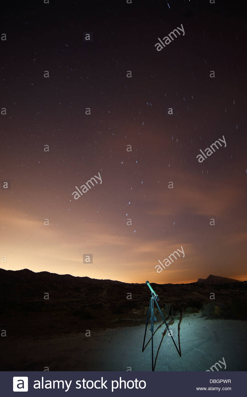 Telescope under the stars, with the movement of the stars - Stock Image