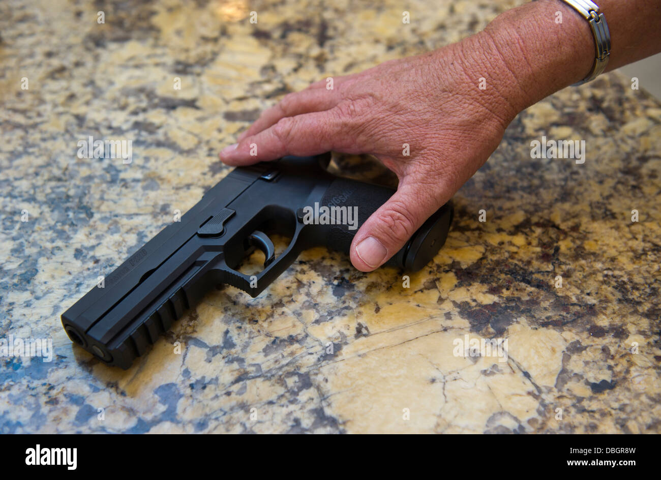 A Sig Sauer P250 gun being kept as a protection against intruders at a private home, Santa Ana, California - Stock Image