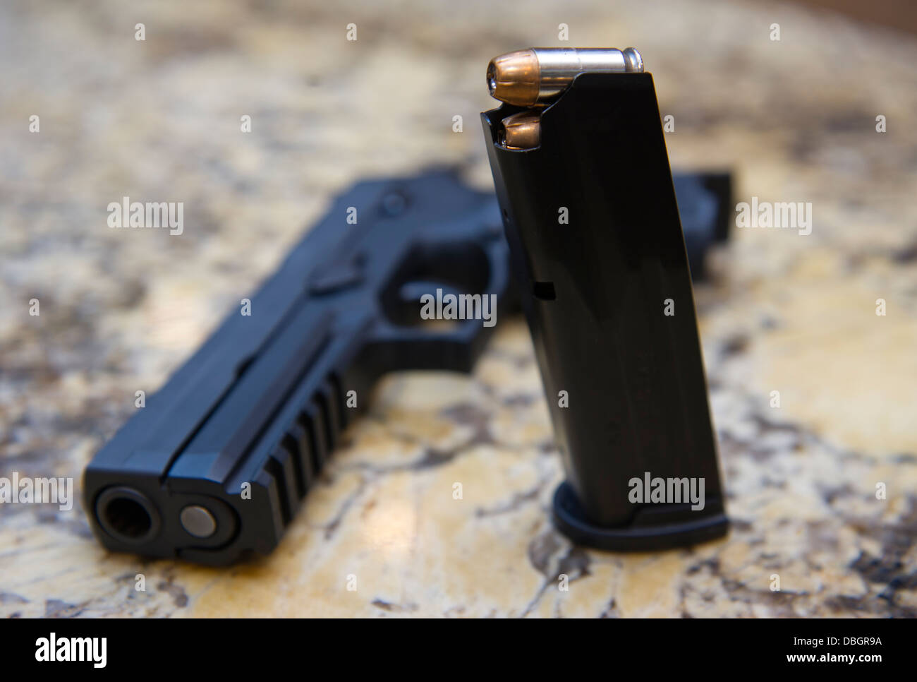 A Sig Sauer P250 gun being kept as a protection against intruders at a private home, Santa Ana, California Stock Photo