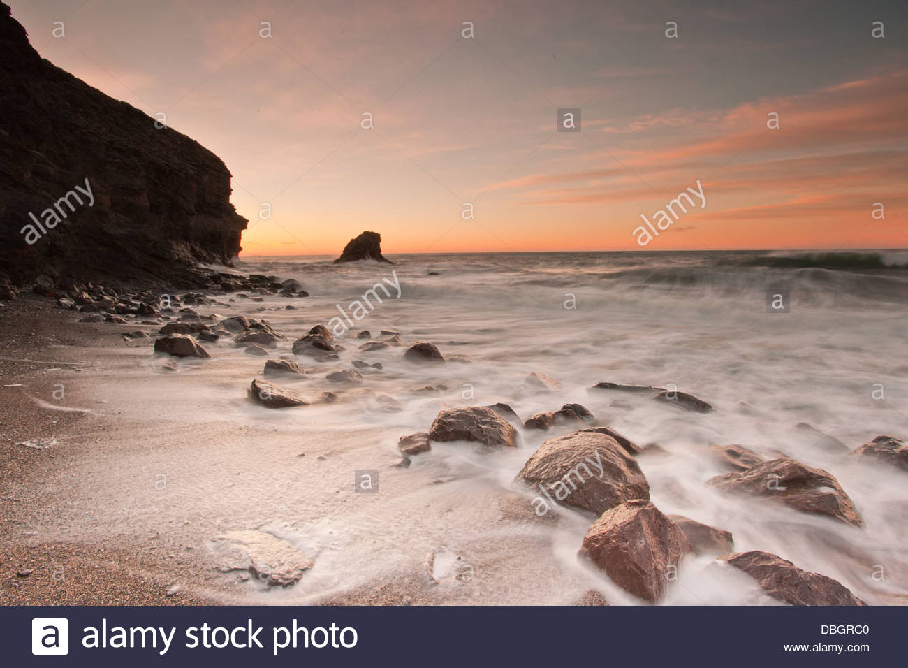 Rising sun at Cala del Barco, in Cartagena, Murcia, Spain. Sunrise at the beach - Stock Image