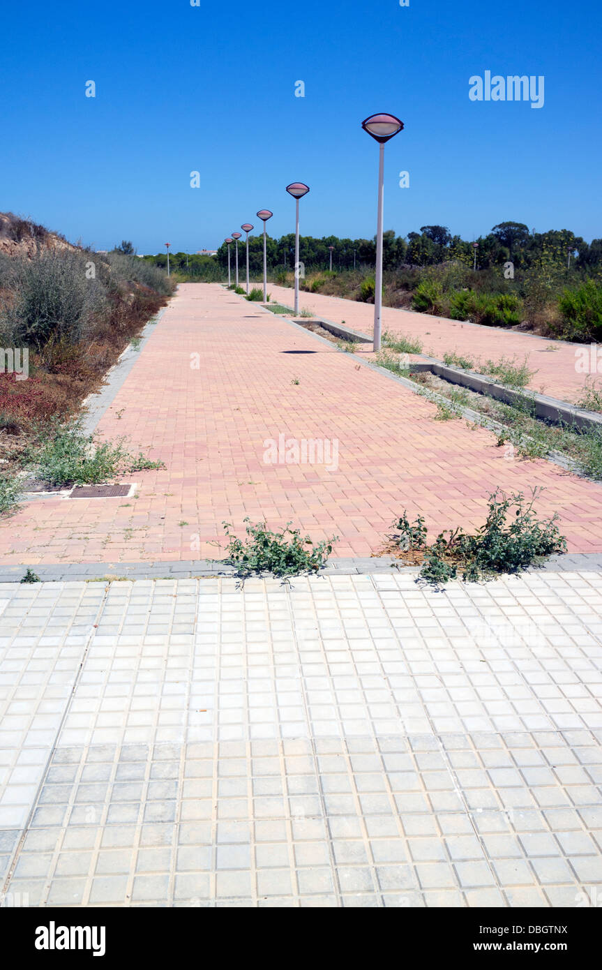 Footpath, Walkway leading nowhere, on an unfinished urbanisation in Costa BlancaSpain - Stock Image