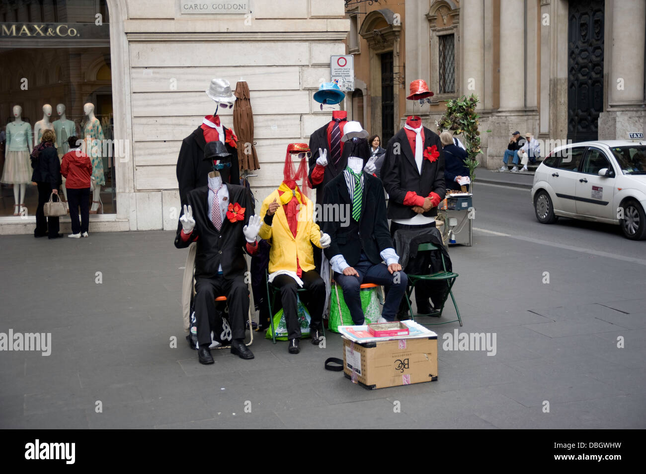 A group of six comic street performers entertaining tourists and locals in Rome, Italy. - Stock Image