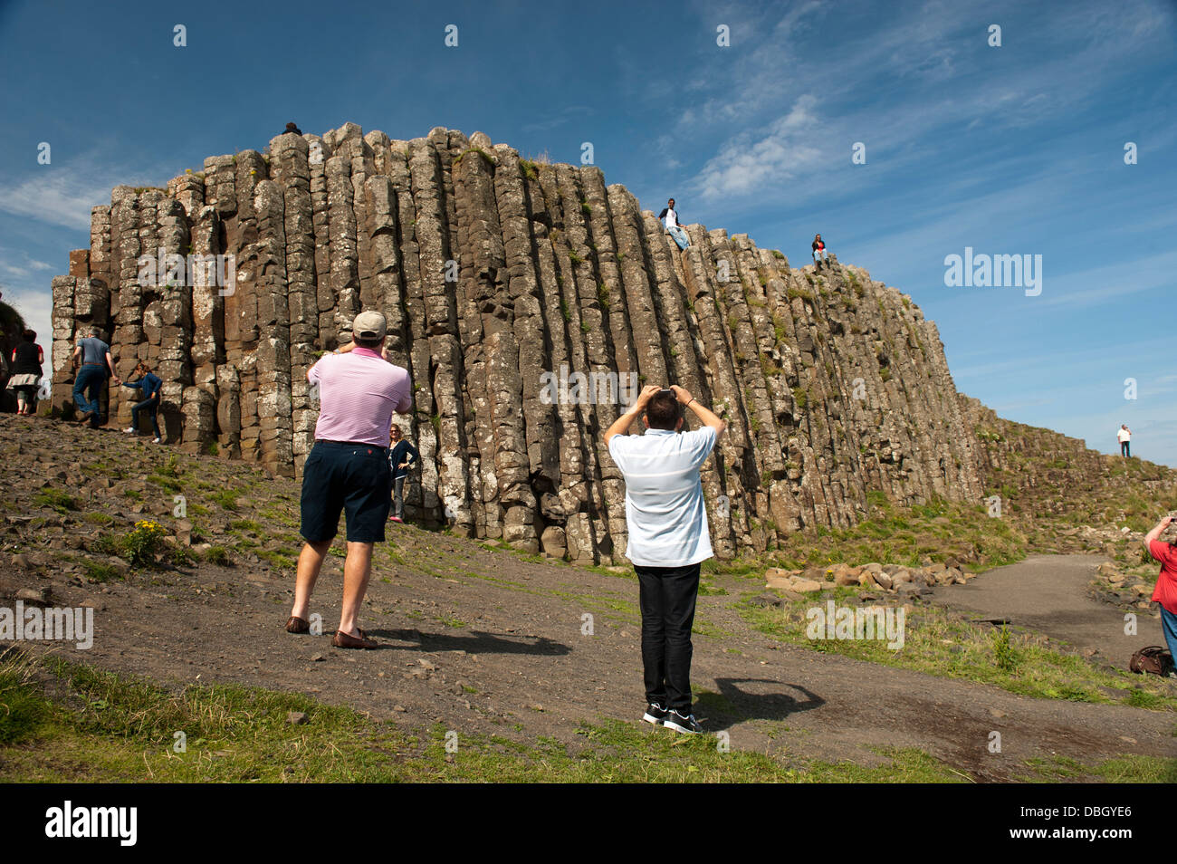 Visitors at the Giants Causeway, Northern Ireland. - Stock Image