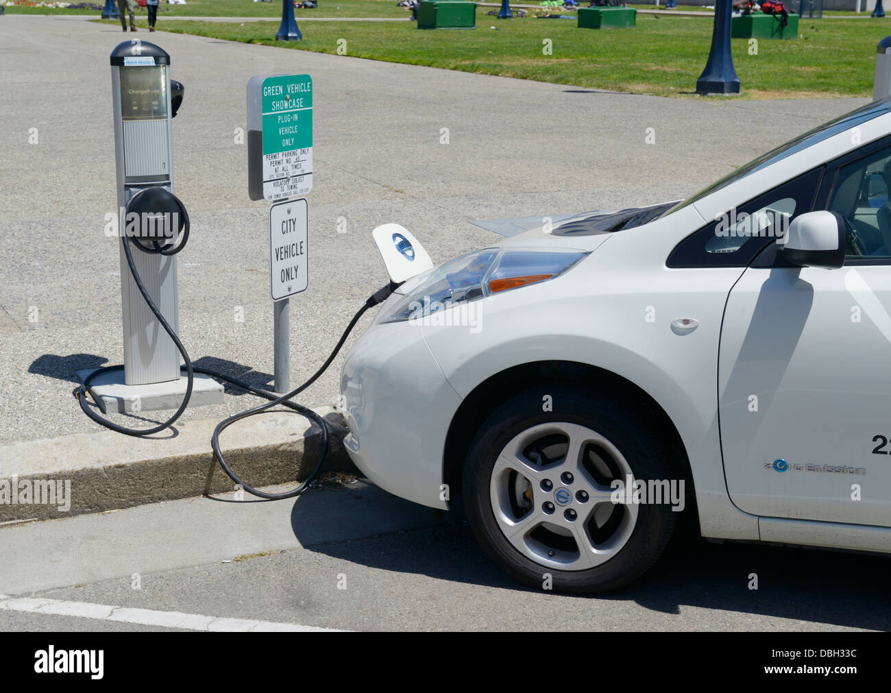 Electric car charging at a reserved space outside of San Francisco City Hall - Stock Image