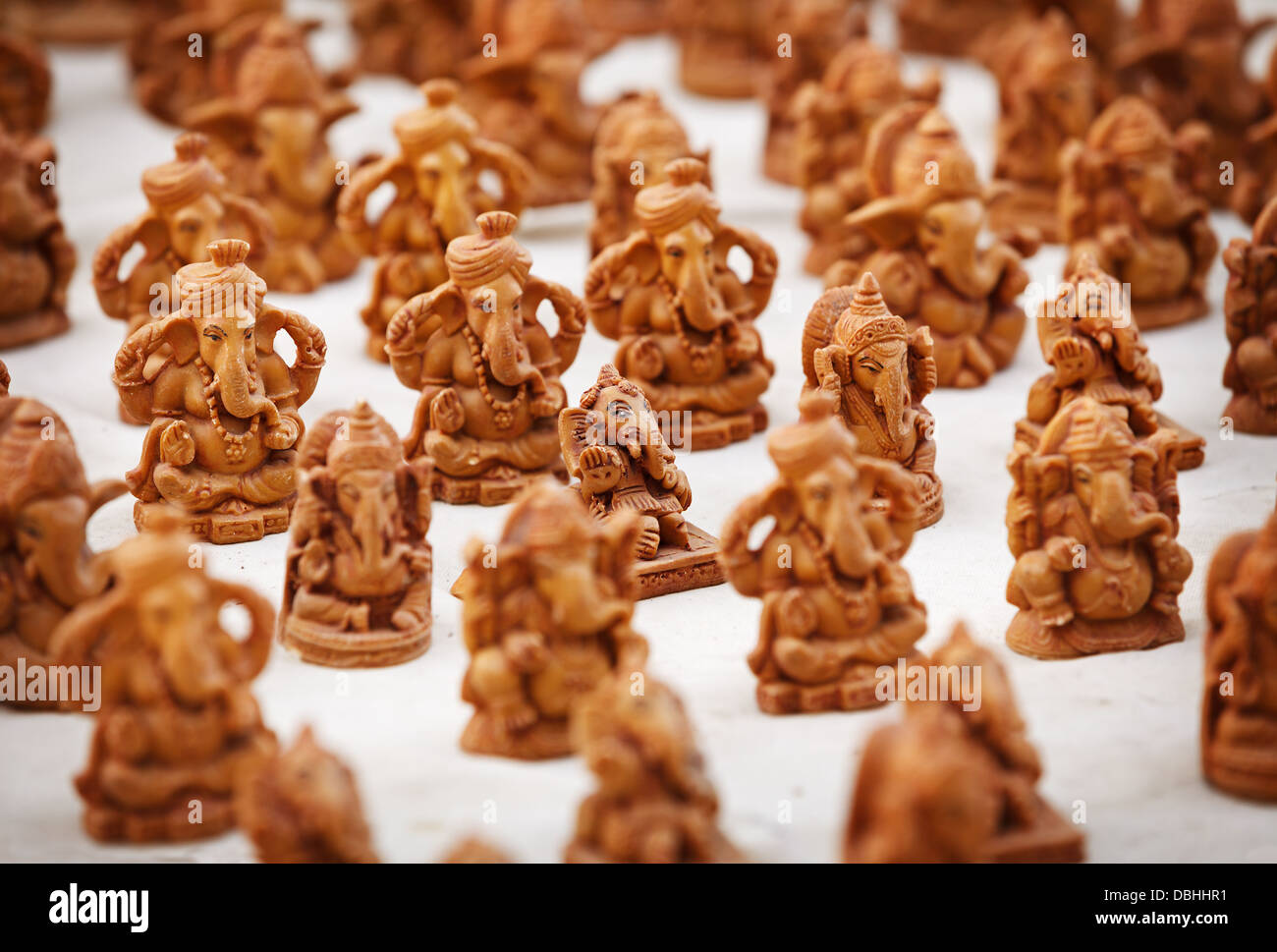 Souvenir figures of gods in the Indian market close up - Stock Image