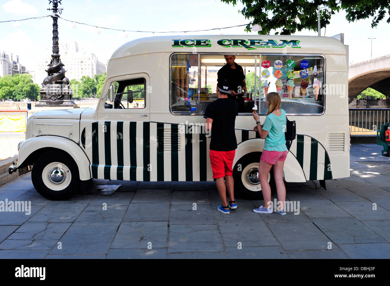 A couple buying ice cream from a van, South Bank, London, UK - Stock Image