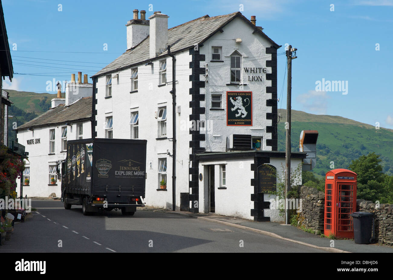 Jennings Brewery delivery van passing the White Lion Inn, Patterdale, Lake District National Park, Cumbria, England - Stock Image