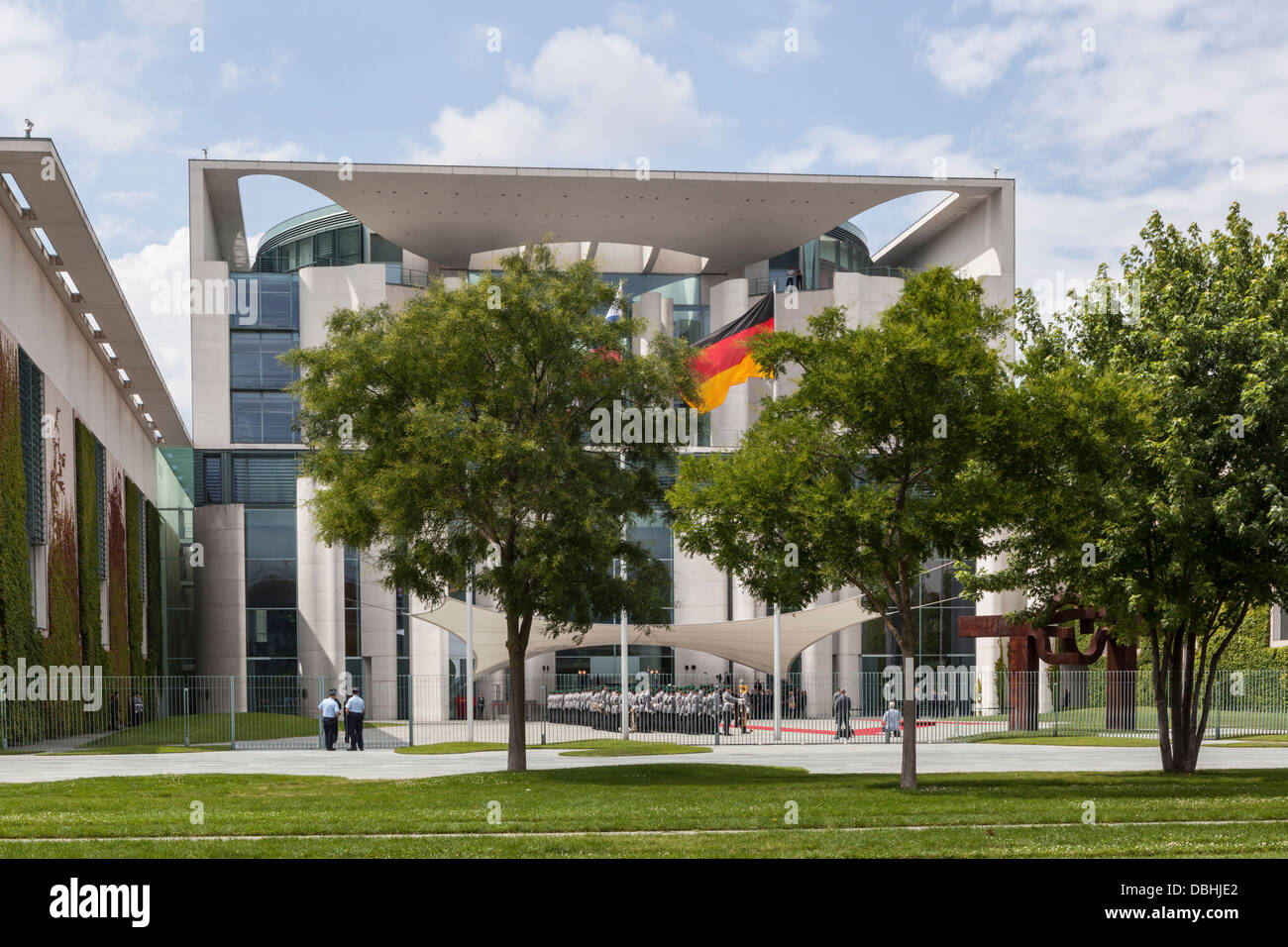 The Wachbataillon parades  in front of the new glass and concrete Chancellery building (Bundeskanzleramt) - Berlin - Stock Image