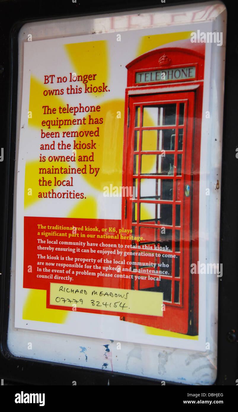 sign inside classic red phone box near Burford, Gloucestershire UK - Stock Image