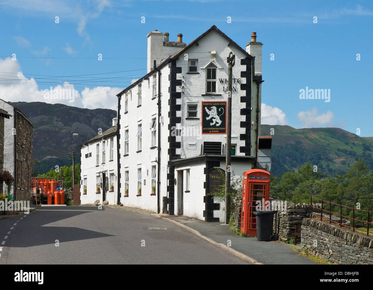 Man delivering Calor Gas bottles to the White Lion Inn, Patterdale, Lake District National Park, Cumbria, England - Stock Image
