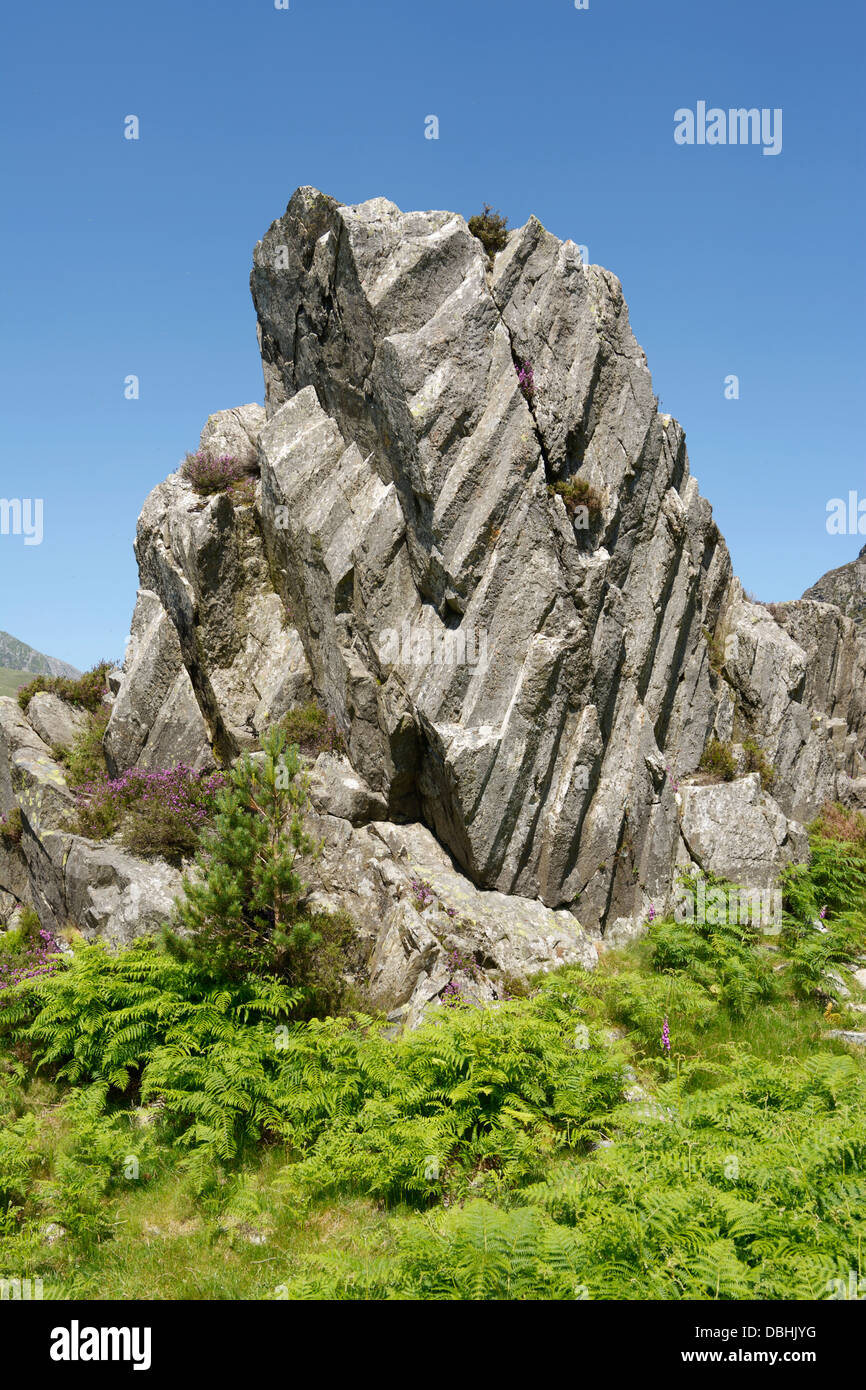 Rock outcrop with organ pipe rock formation. - Stock Image
