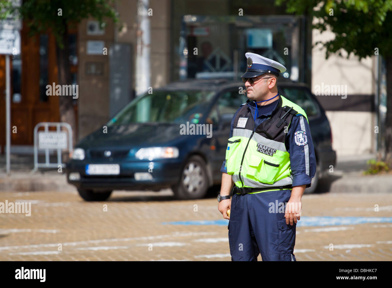 Bulgarian traffic policeman in reflective vest; central Sofia. - Stock Image