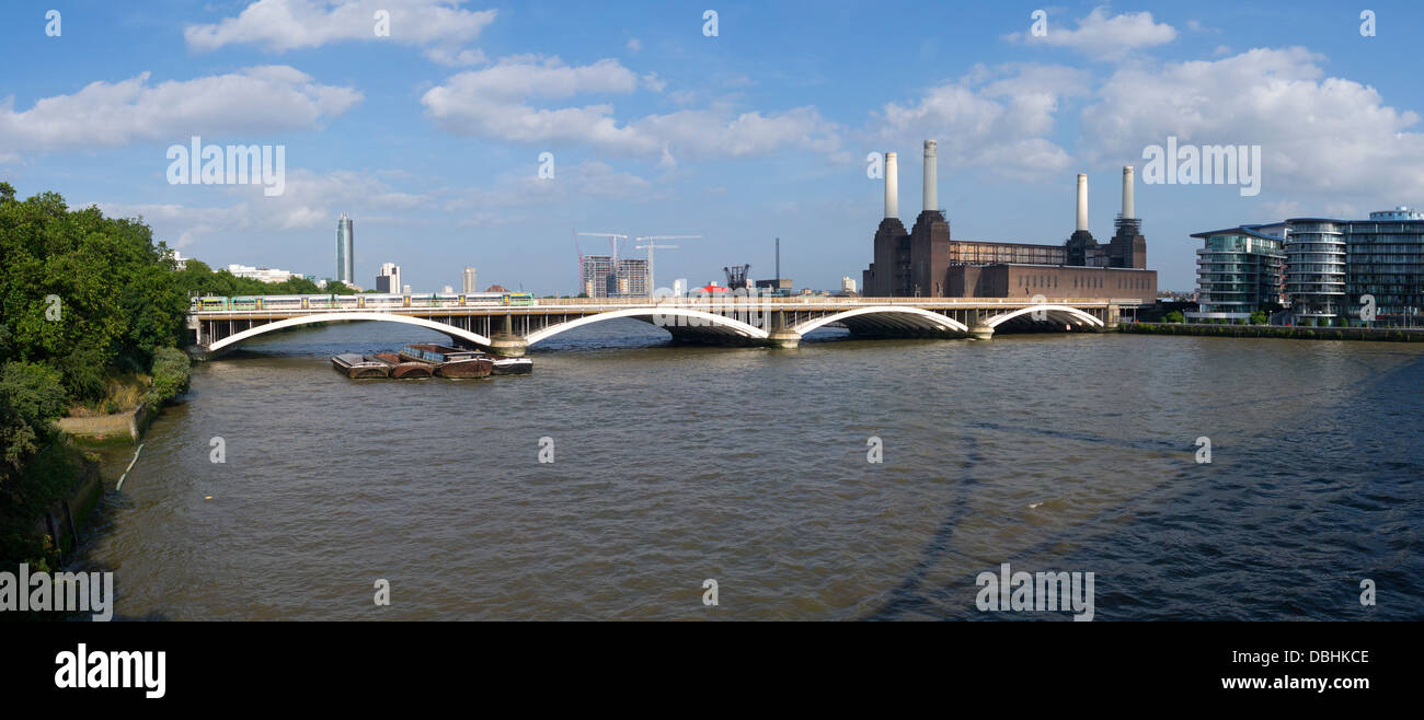 Battersea railway bridge, power station and the river Thames panorama.  London England. - Stock Image