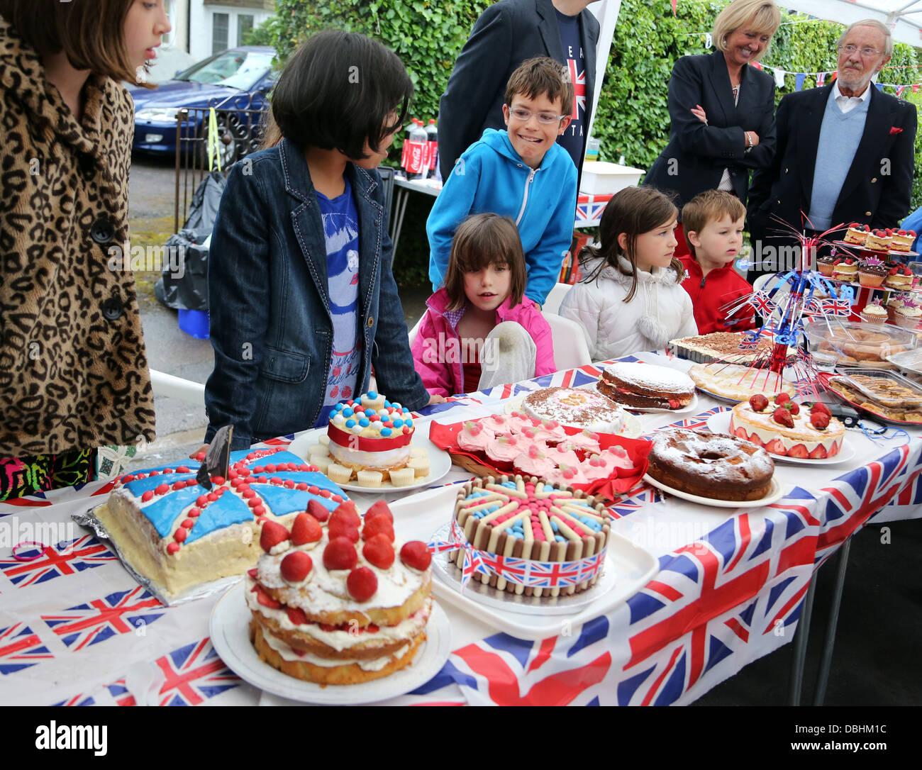People Looking At Cakes During Cake Competition At Street Party During Queen's Diamond Jubilee Surrey England - Stock Image