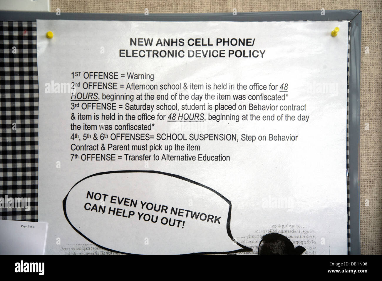A sign on a suburban high school wall in Aliso Viejo, CA, lists escalating penalties for unauthorized use of cell - Stock Image