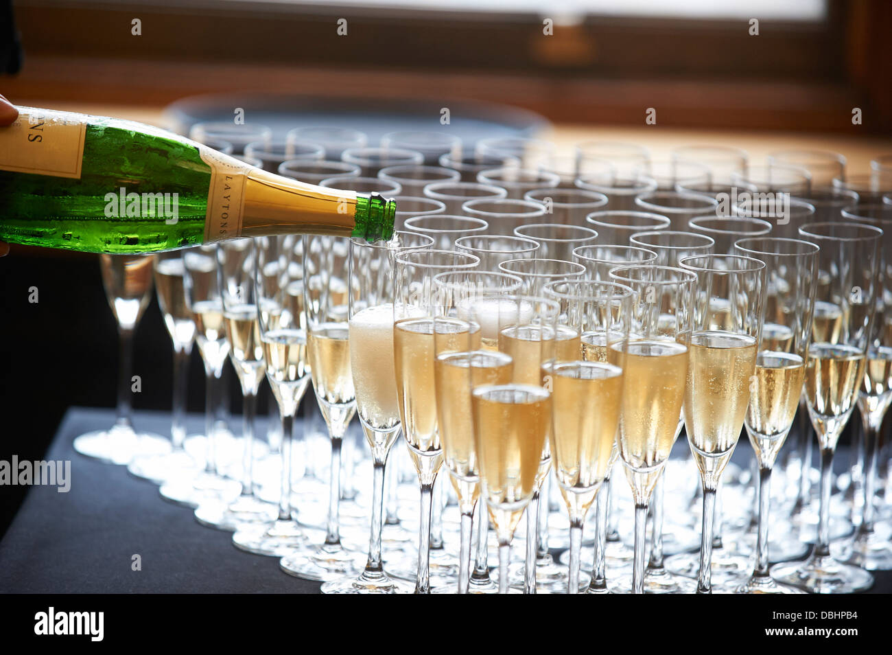 pouring champagne - Stock Image