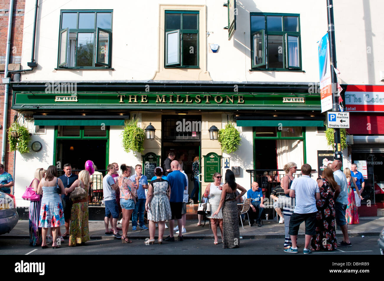 People drinking at The Millstone Pub, Thomas Street, Central Manchester, UK - Stock Image