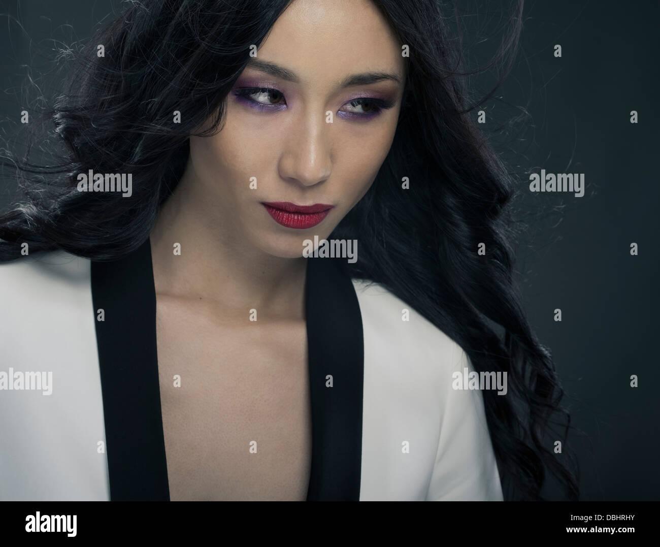 beautiful asian woman in her twenties wearing black and white jacket