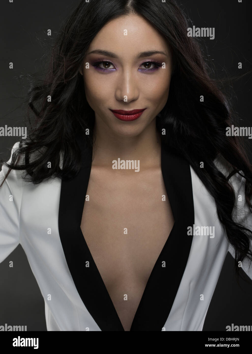 Beautiful asian woman in her twenties wearing black and white jacket