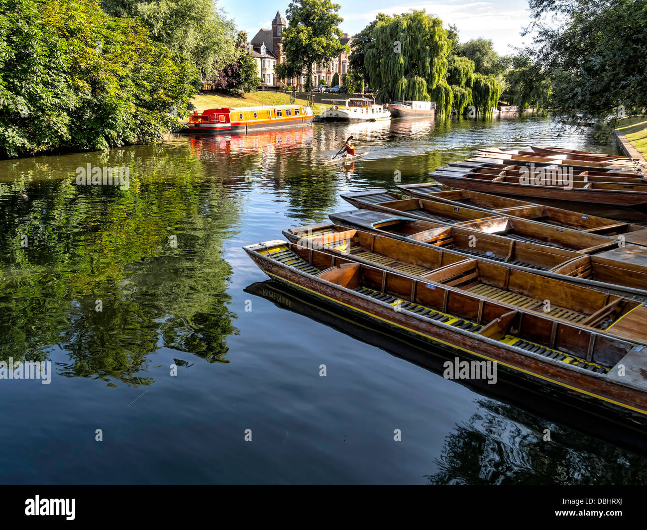 Punts lined up on river in Cambridge England - Stock Image