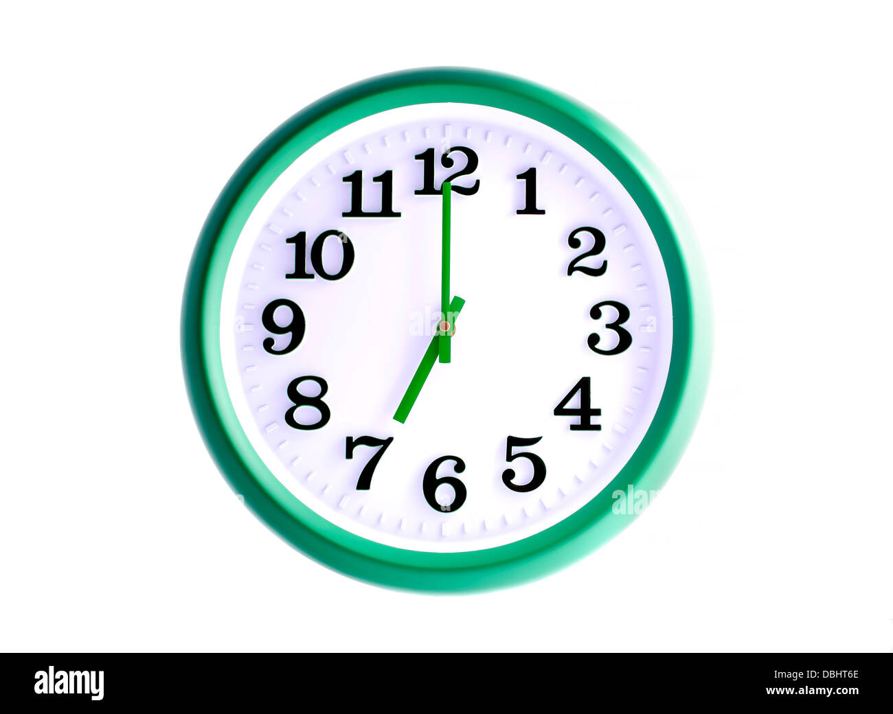 Isolated green wall clock on white background - Stock Image