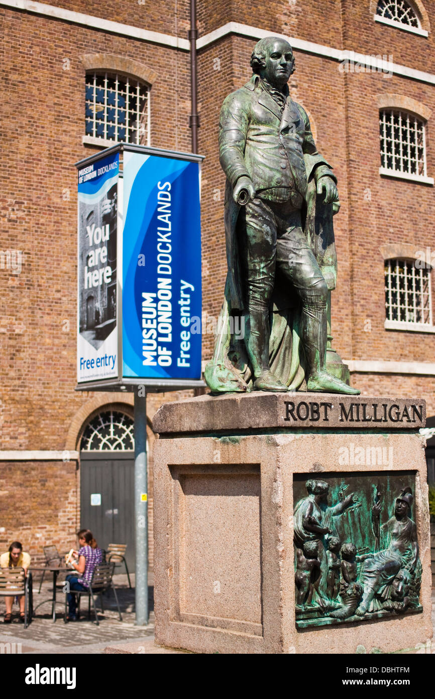 Robert Milligan statue stands in front of the museum of London Docklands - Stock Image