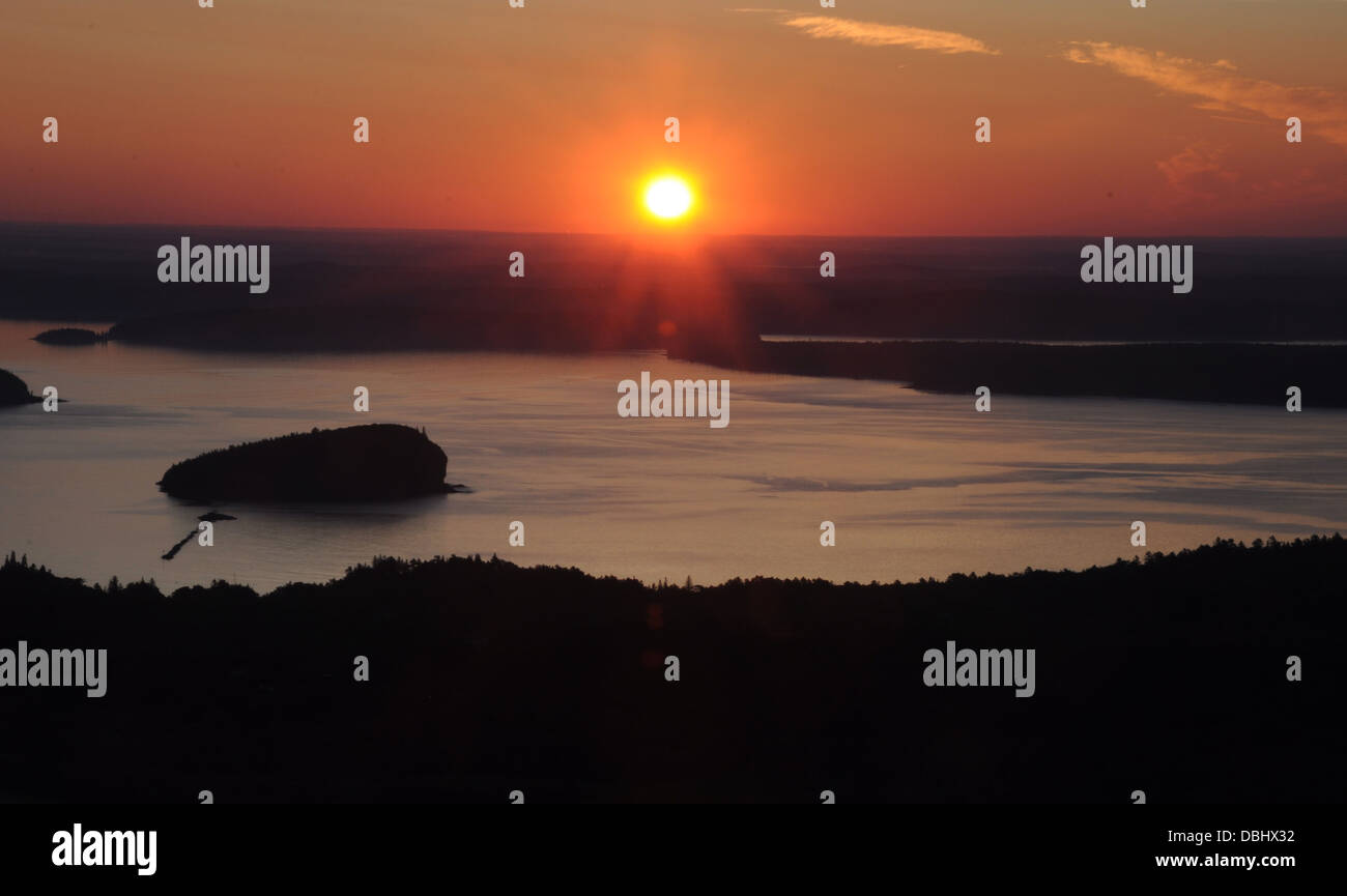 The rising sun over the islands around Mount Desert Island Maine taken from the top of Cadilliac Mountain - Stock Image