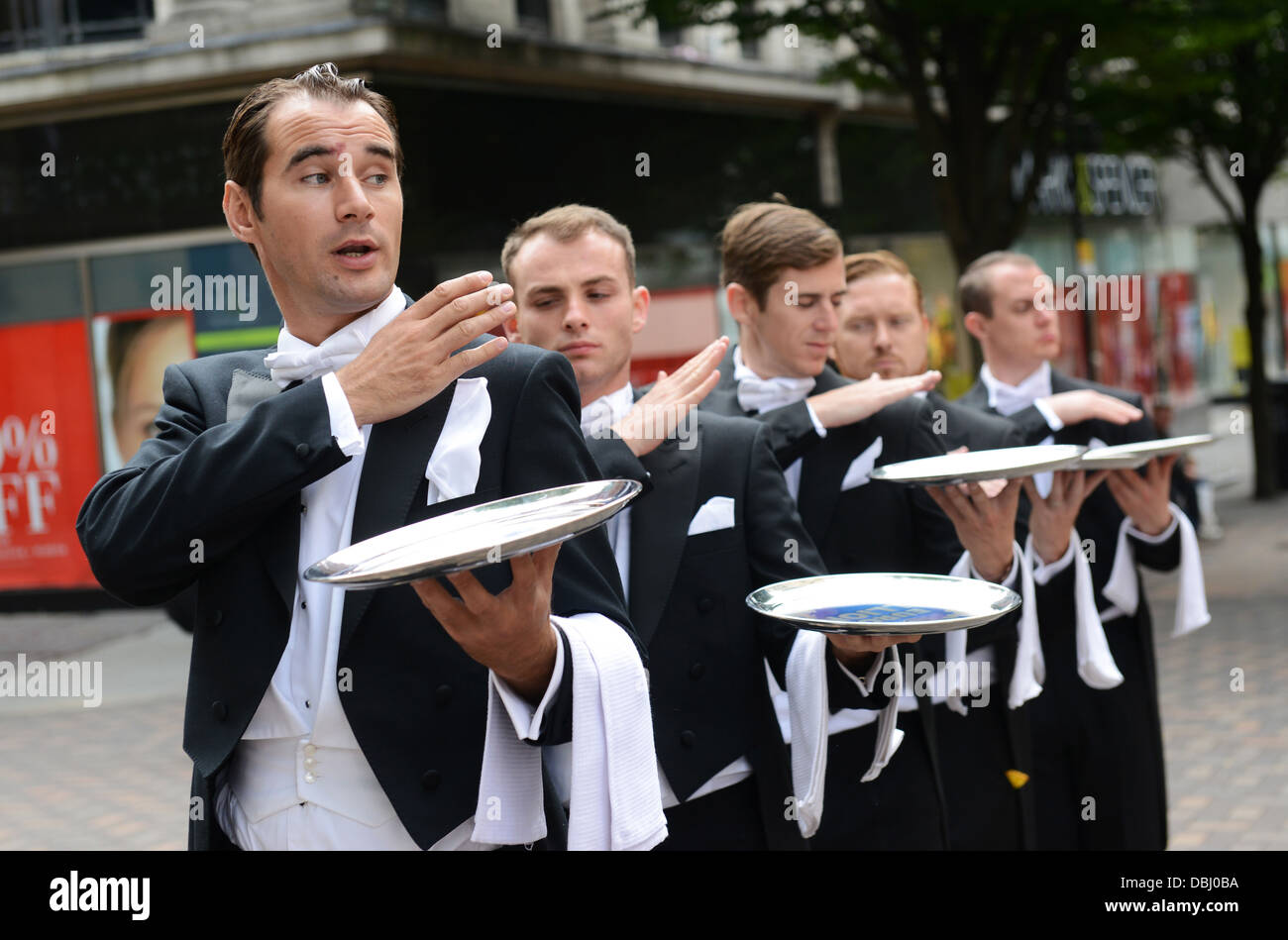 Butlers on parade promoting Euro Millions lottery posed by male models - Stock Image
