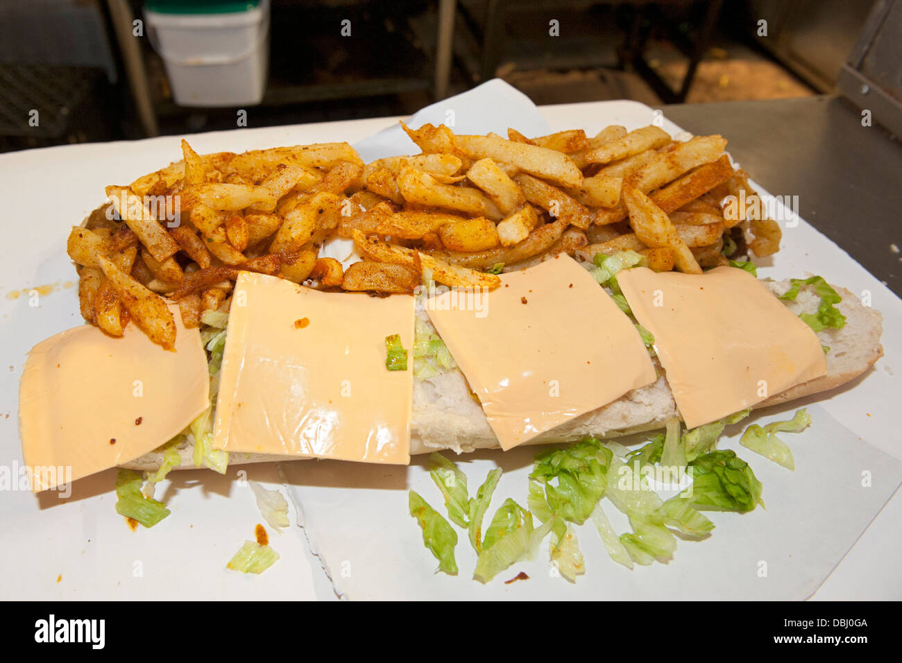 Full House gatsby sandwich being prepared at the Golden Dish take away in Athlone, Cape Town, South Africa. Stock Photo