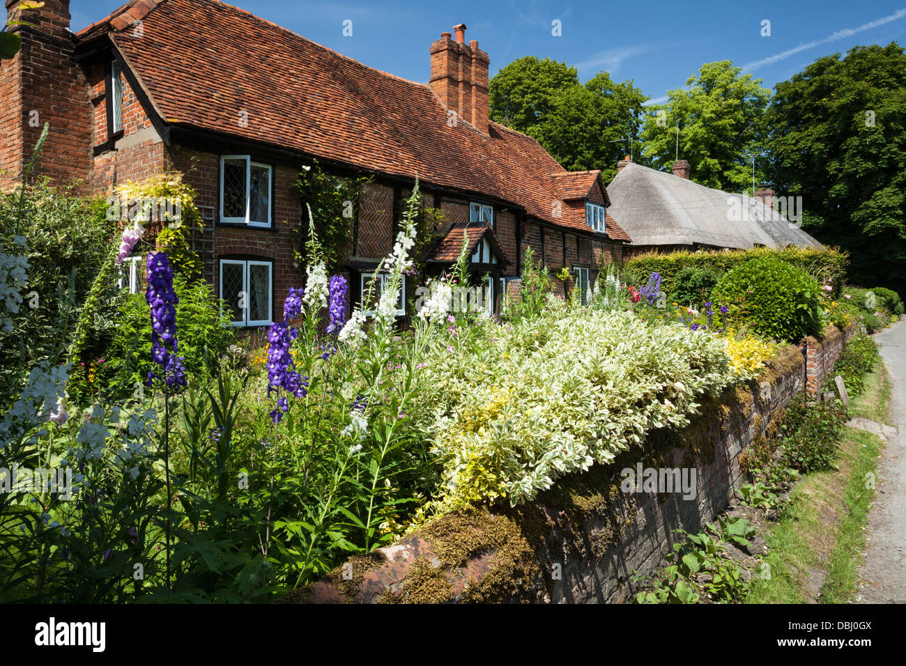 A traditionally built red brick and timber-framed house dating from 1590 with a pretty cottage garden, Monks Risborough, - Stock Image