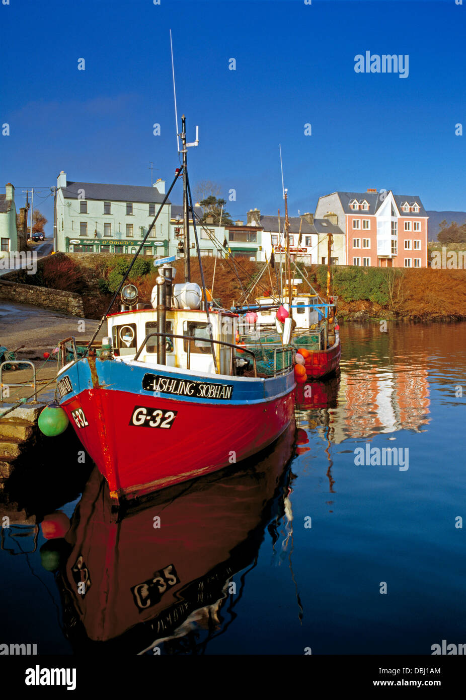 Fishing boats, early morning in the harbour of the Connemara village of Roundstone, county Galway, Ireland - Stock Image