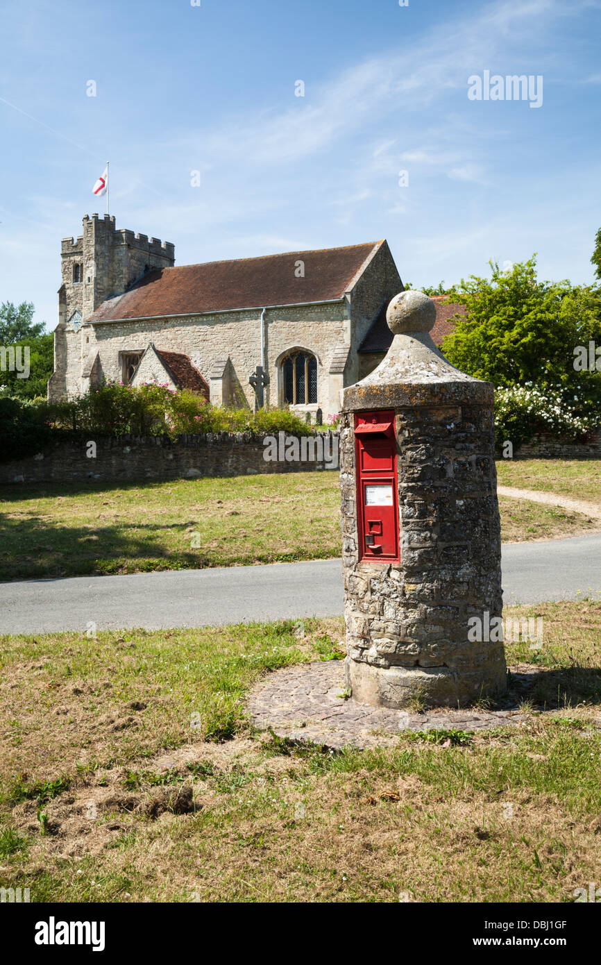 A red victorian postbox set within an unusual stone pillar in the village of Nether (Lower) Winchendon, Buckinghamshire, - Stock Image