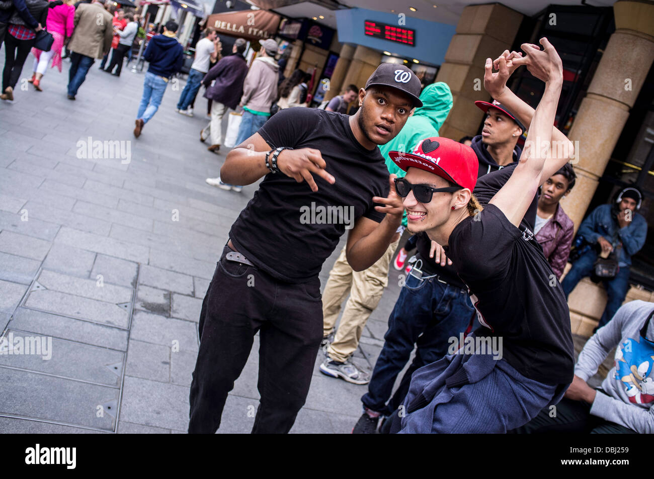 Young people in Leicester Square, London, United Kingdom - Stock Image