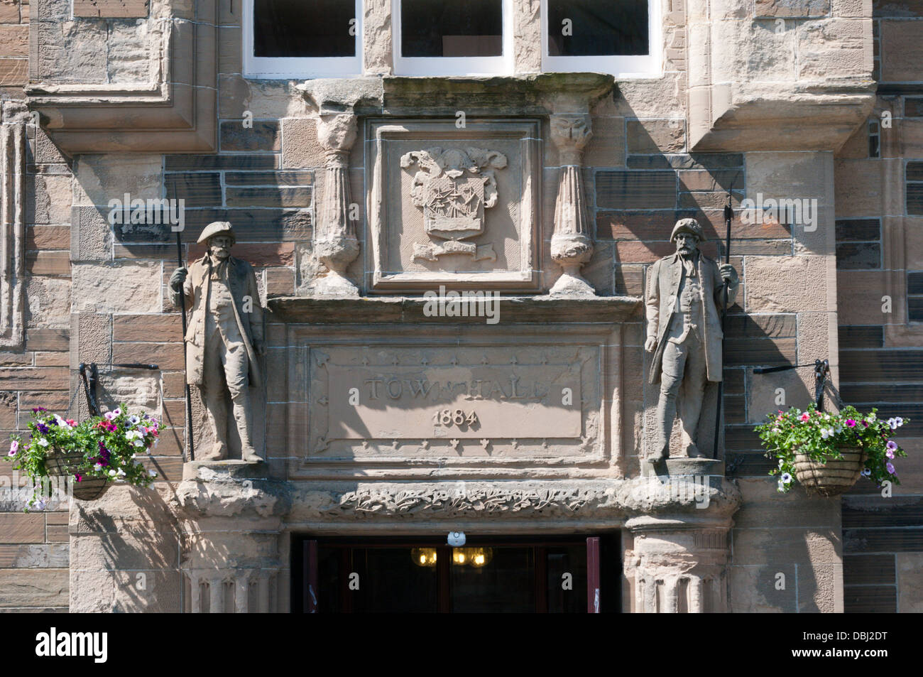 Carving over the entrance to Kirkwall Town Hall, Orkney. - Stock Image