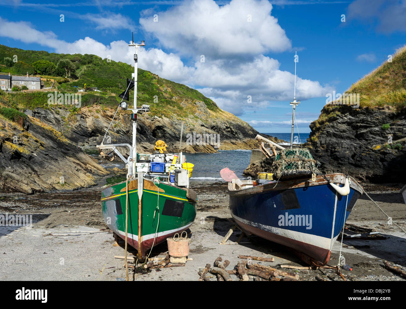 Colourful fishing boats on the beach at Portloe a small fishing village on the south coast of Cornwall - Stock Image