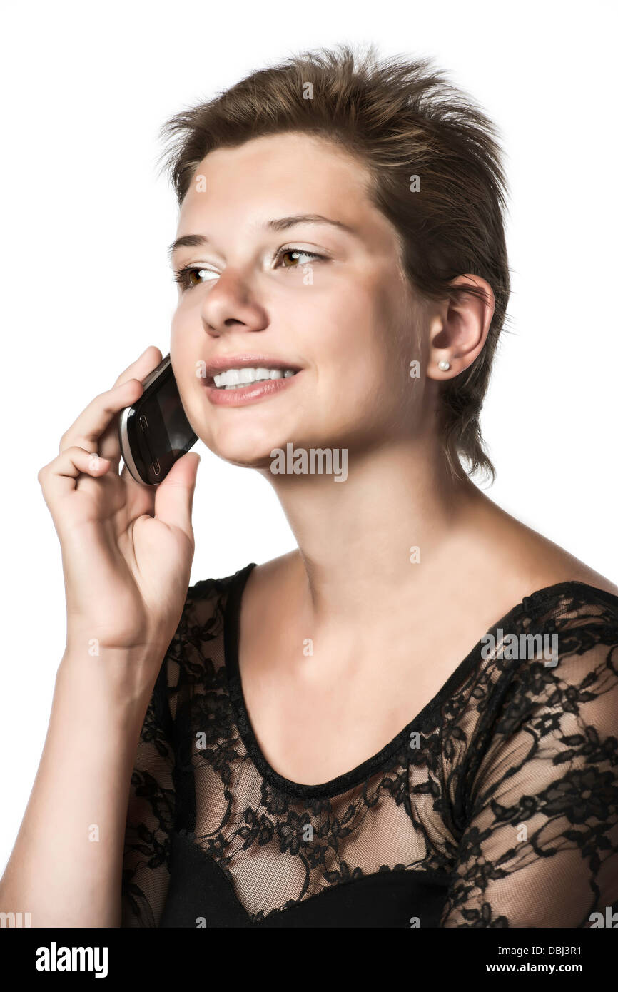 Girl phoning with cellphone in the evening dress, isolated on white background - Stock Image