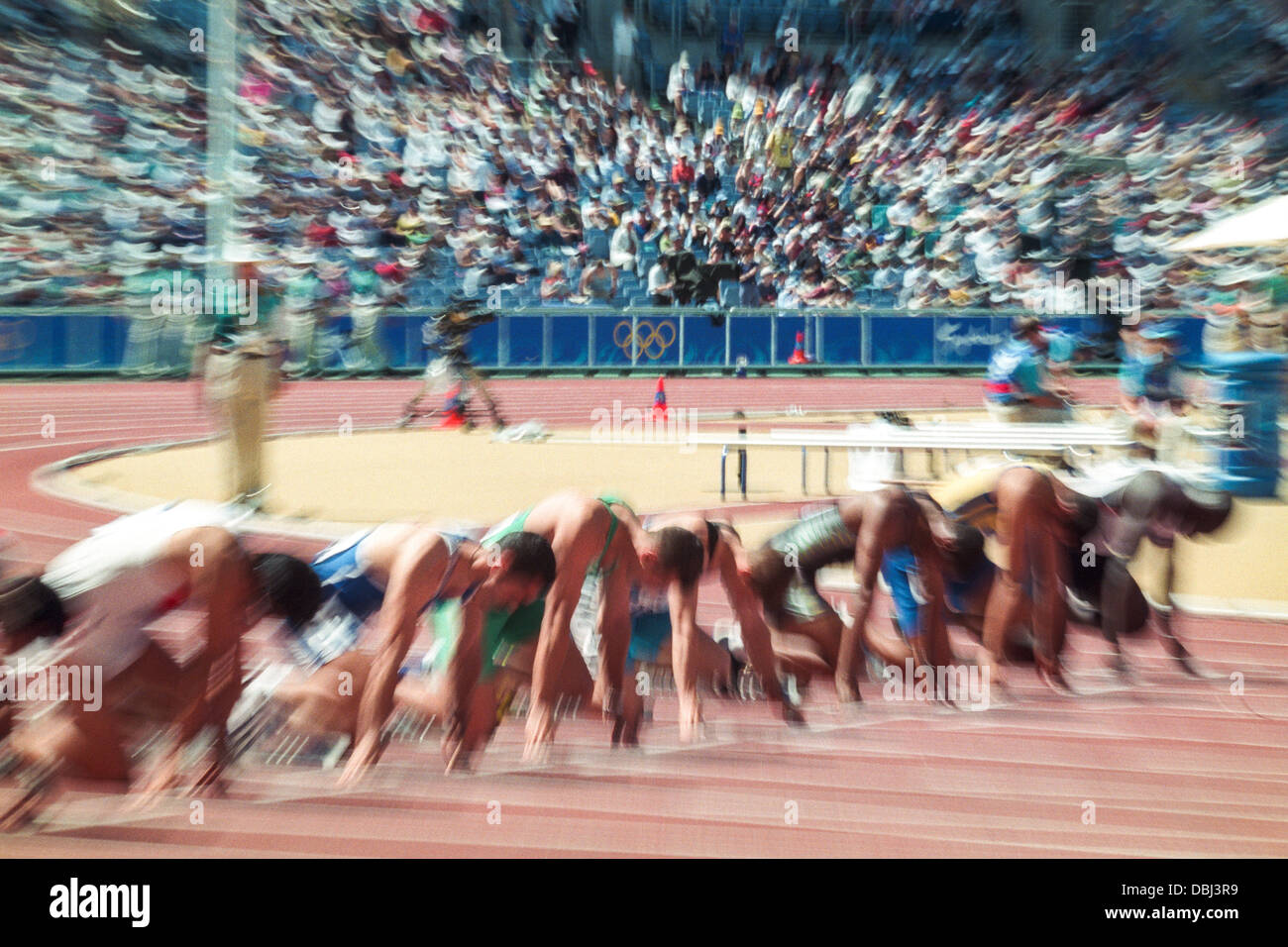 Blur motion image of the start of a 100 meter race at the 2000 Olympic Summer Games. - Stock Image