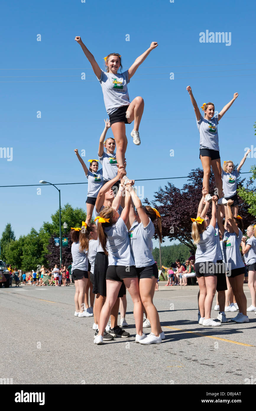 Cheerleaders raised in the air. - Stock Image