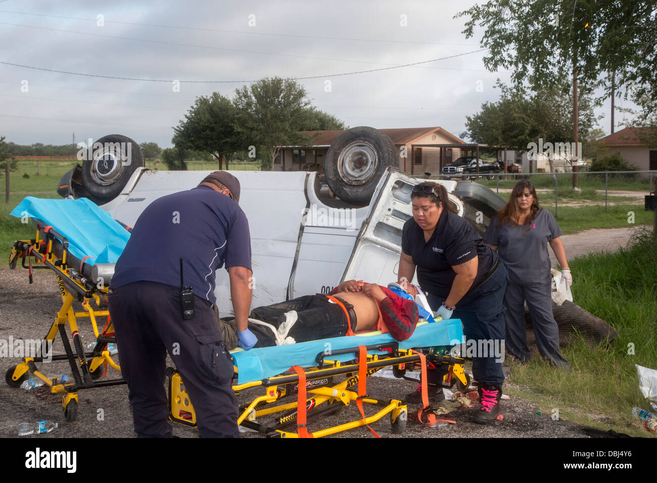 Falfurrias, Texas - An van holding 26 undocumented immigrants from Central America overturned on Texas Highway 285. - Stock Image