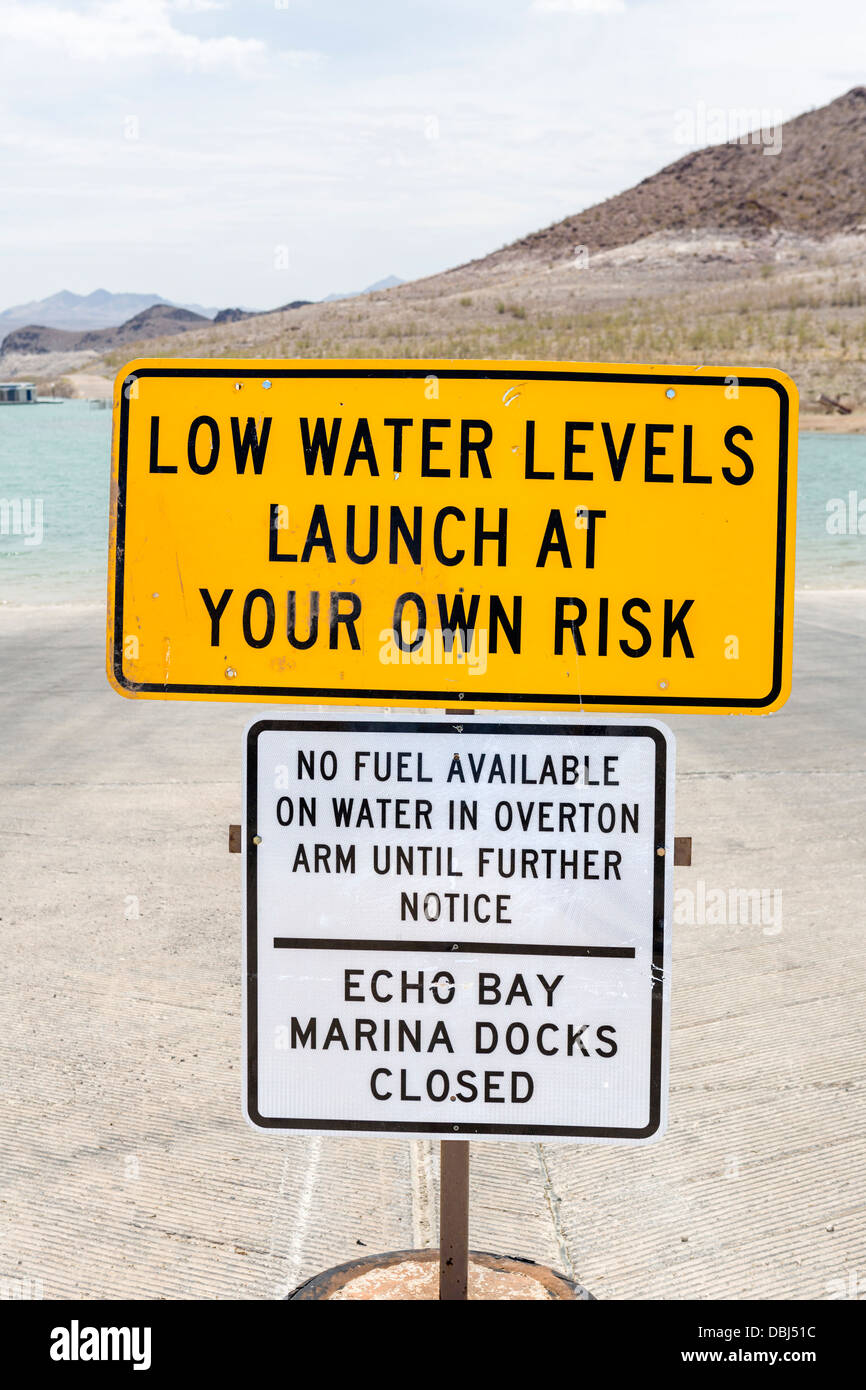 Warning of low water levels on boat ramp at Lake Mead in summer 2013, Echo Bay Marina, Lake Mead, Nevada, USA Stock Photo