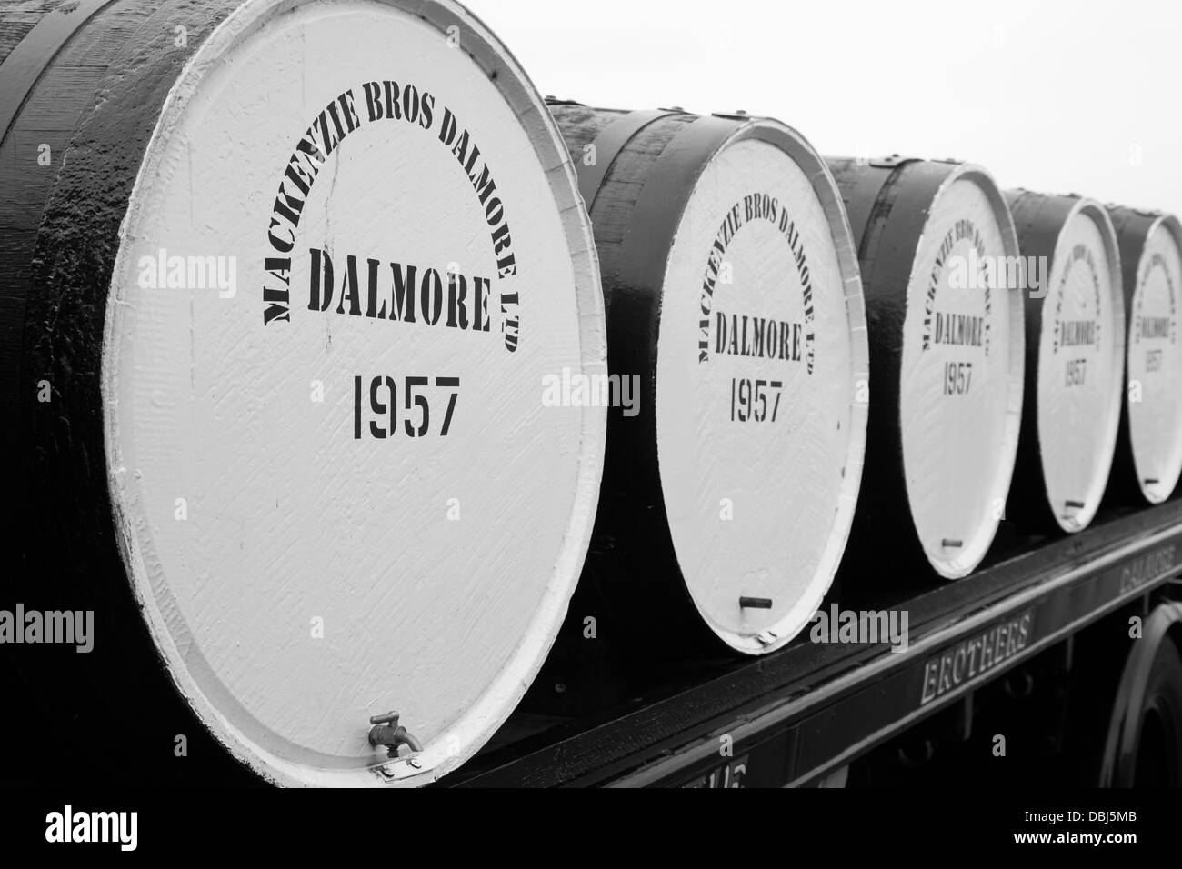 Large whisky casks or barrels on a flatbed lorry at Dalmore is a distillery in Alness, Scotland, located about 20 - Stock Image