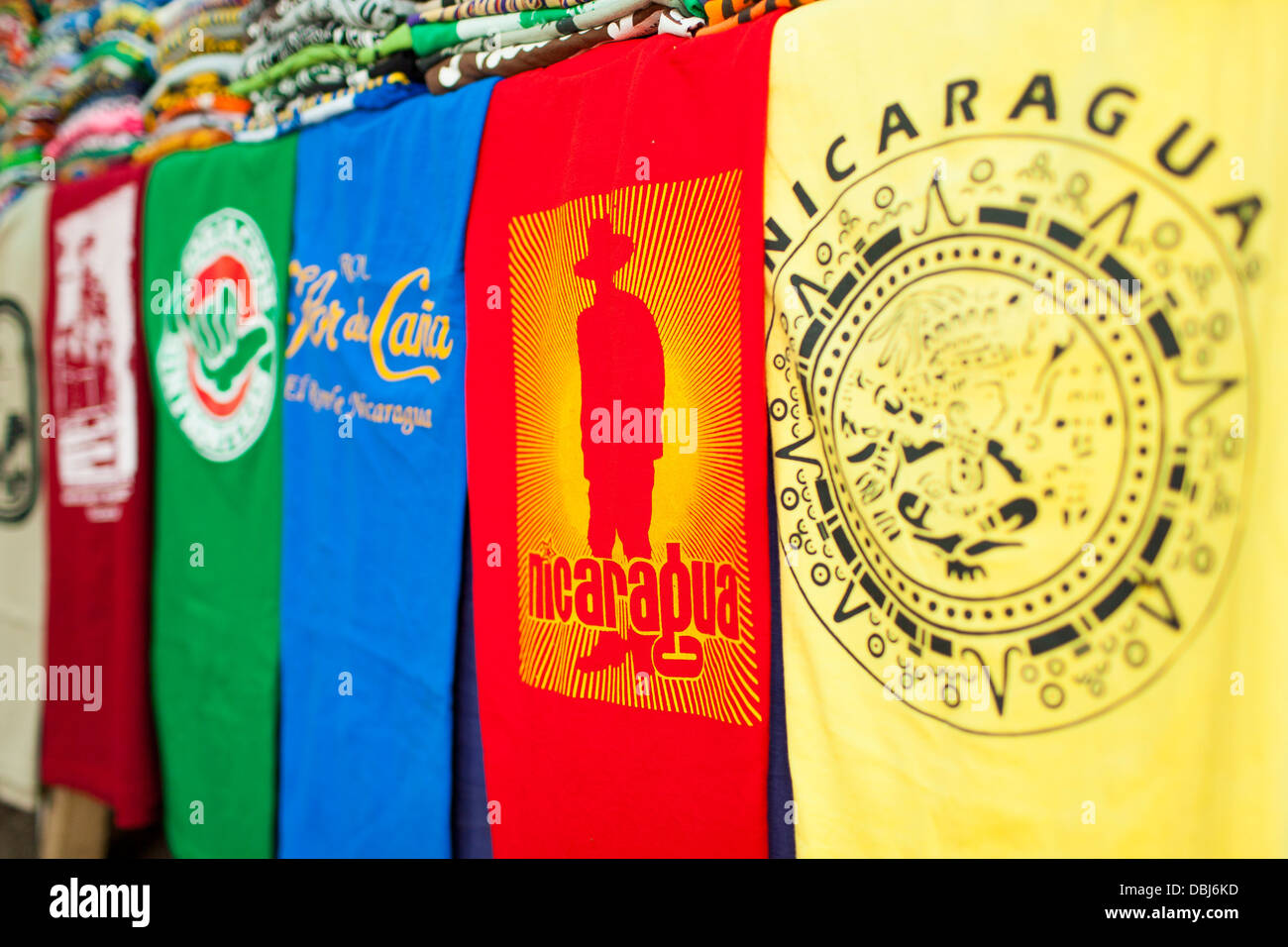 Souvenir tee shirts for sale in the central plaza of Grenada in Nicaragua Central America - Stock Image