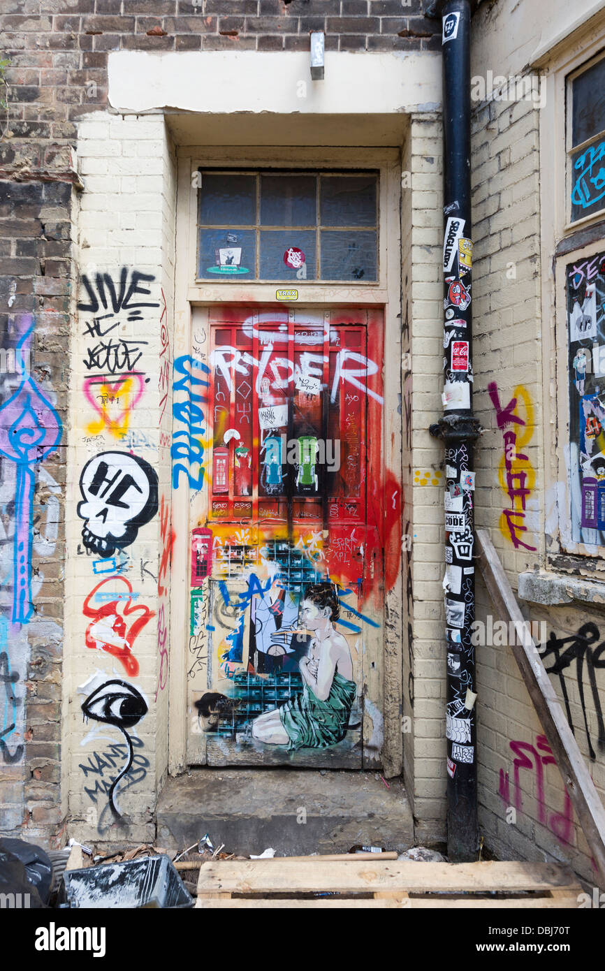 Door and walls covered in graffiti brick lane area london