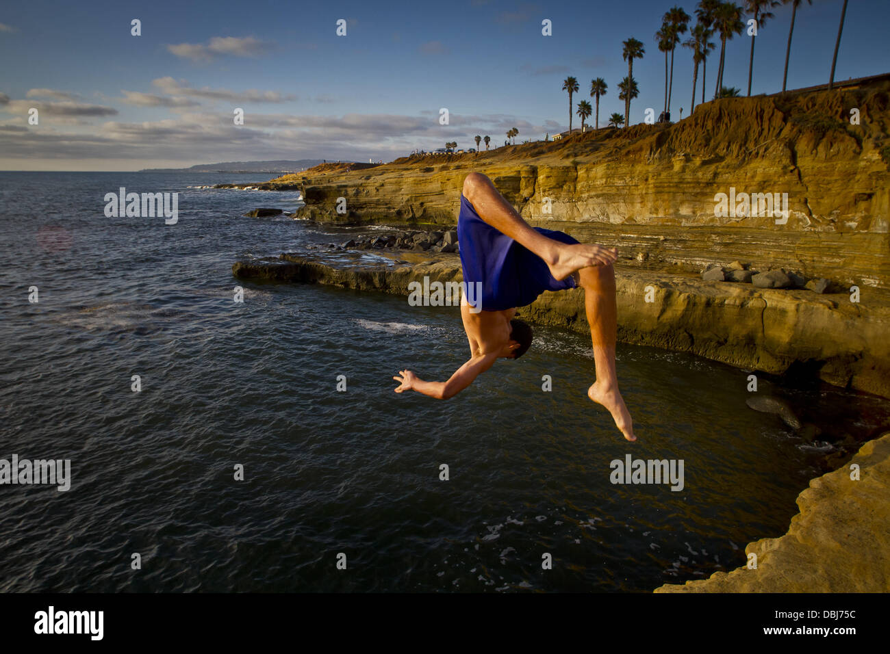 San Diego, California, USA. 30th July, 2013. A daredevil does a backflip off the lip into the water at Sunset Cliffs - Stock Image