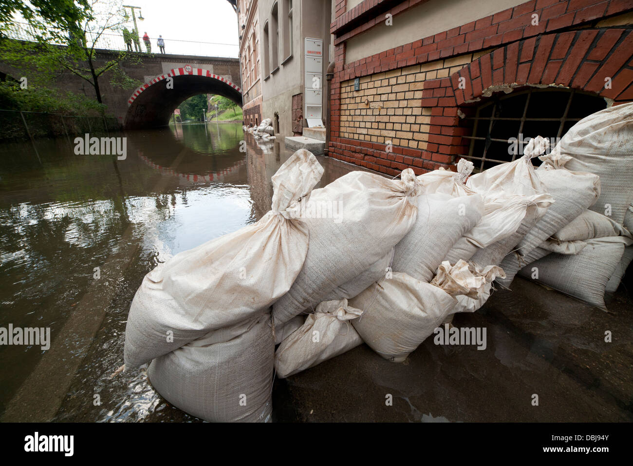 sandbags across the cellar windows of a house as protection against flooding of the river Saale in Halle (Germany); - Stock Image