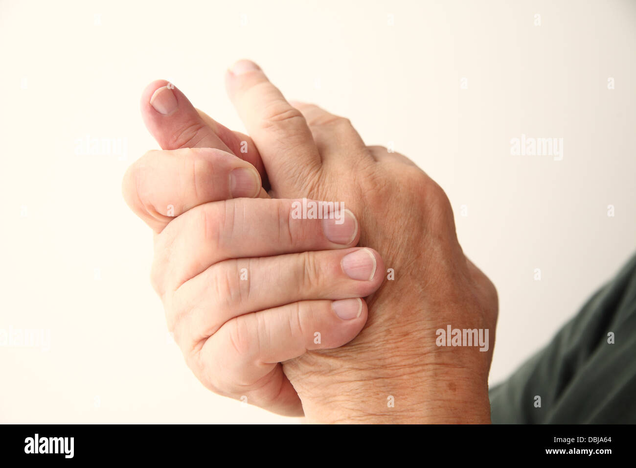 closeup of man with an aching little finger - Stock Image