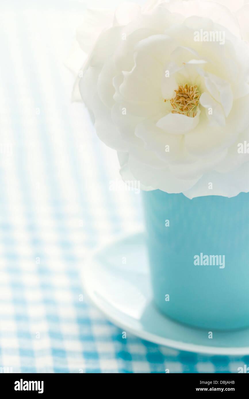White Rose In A Light Blue Vase On Shabby Chic Vintage Background