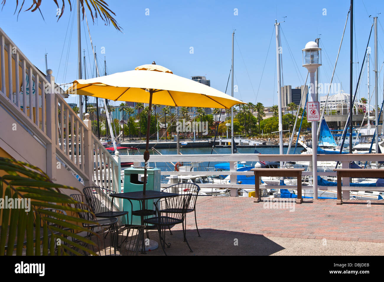 Yellow umbrella and accommodations in Long Beach California. - Stock Image