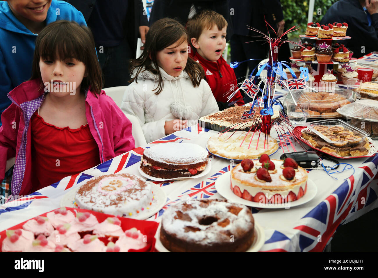 Children Looking At Cakes During Cake Competition At Street Party During Queen's Diamond Jubilee Surrey England - Stock Image