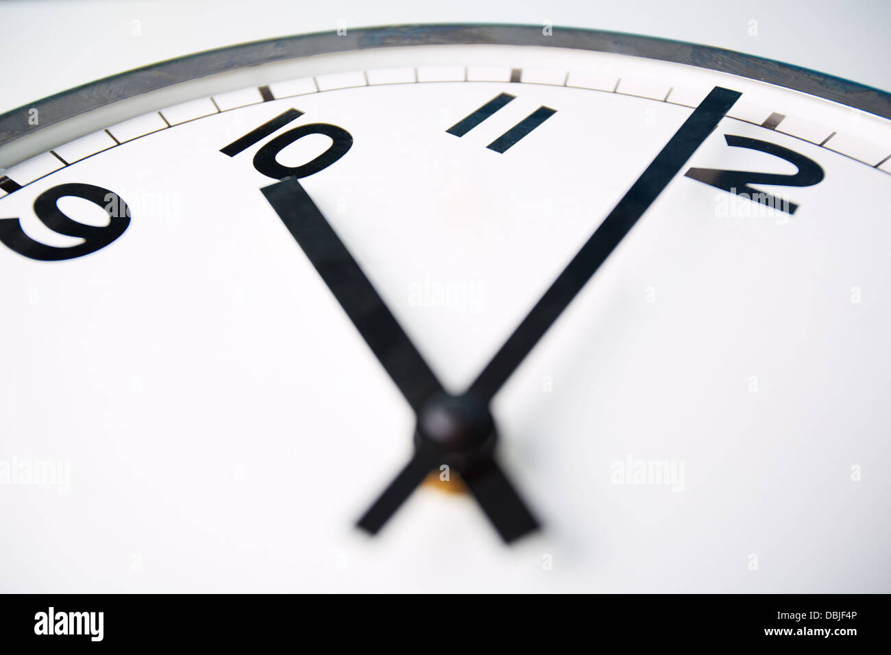 Macro shot of a clock face showing ten o'clock - Stock Image